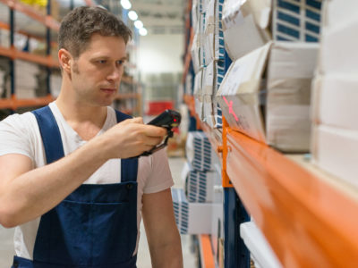 Supervisor scanning package barcode at the warehouse.