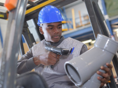 warehouseman with protective vest and scanner
